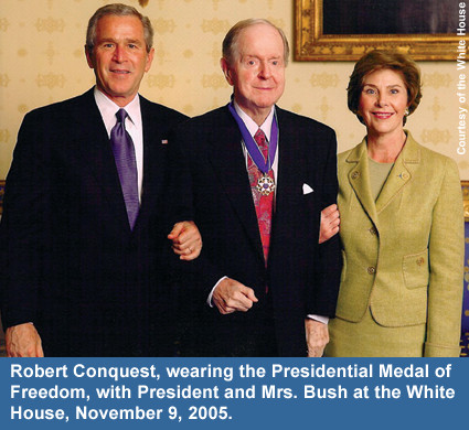 Robert Conquest, wearing the Presidential Medal of Freedom, with President and Mrs. Bush at the White House, November 9, 2005.