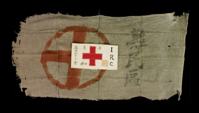 A tattered flag and armband of the International Red Cross survive from the 1937 Nanjing massacre.
