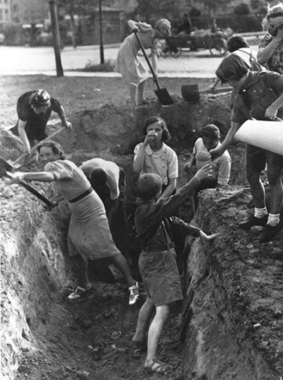 Polish civilians, including children, dig an antitank trench in 1939 as the Battle of Warsaw commences.