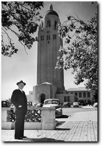 Former president Herbert Hoover poses with his namesake tower in August 1951.