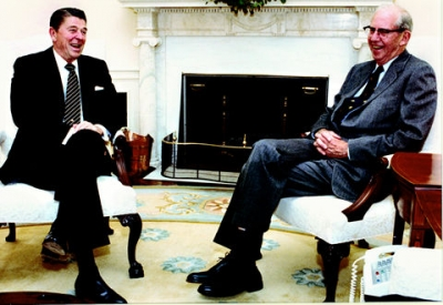 Ronald Reagan and George Stigler share a story in the White House, October 27, 1982.