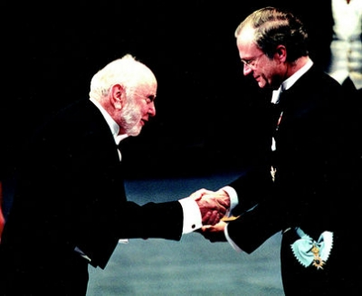Douglass C. North receives the 1993 Bank of Sweden Prize in Economic Sciences in Memory of Alfred Nobel from King Carl XVI Gustaf of Sweden.