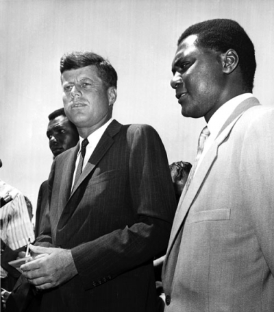 Democratic presidential candidate John F. Kennedy meets with Tom Mboya, right, at Hyannisport in July 1960