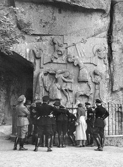 Himmler and party examine a bas-relief at the Externsteine, a rock formation in northwest Germany with ritualistic associations.
