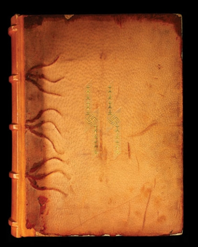 Runes and swastikas decorate the cover of one of Heinrich Himmler's personal photo albums.
