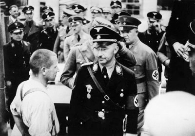 Himmler on an official visit to Dachau, 1936.