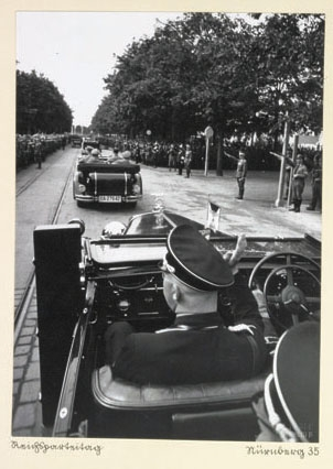 Himmler in a official motorcade, 1935.