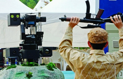South Korean soldier surrenders to a machinegun- armed robot