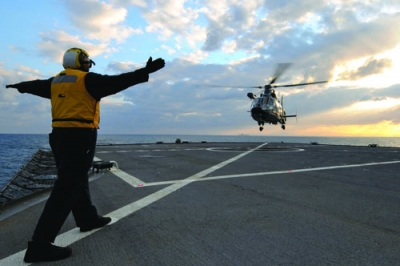A French rescue helicopter lands aboard the U.S. amphibious command ship